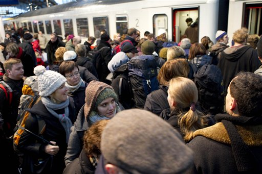 Passengers board a train departing from Berlin's central railway station to Schiphol, Netherlands, after the reopening of a track between Berlin and Hanover in Berlin, Germany, Friday, Dec. 24, 2010. The track is the most important East to West connection in Germany and was closed due to frosted overhead contact installations for the traction system in the morning. German news agency Dapd reports that five trains with a total of 700 passengers onboard got stuck due to the weather conditions. (AP Photo/Gero Breloer)
