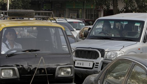 In this Monday, Nov. 1, 2010 photo, an SUV driver, right, tries to forcefully make his way from the wrong side, amidst heavy traffic in New Delhi, India. Around 10 million cars, buses, trucks and an army of scooters and motorbikes pack into the cities potholed roads each day, causing unending traffic jams, frayed tempers and gridlock. A global road safety report by the World Health Organization says more people die in road accidents in India than anywhere else in the world, a phenomenon blamed on poor roads, speeding, and dangerous and reckless driving. (AP Photo/Manish Swarup)