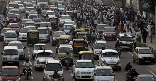In this Monday, Nov. 1, 2010 photo, haphazard traffic is seen in New Delhi, India. Around 10 million cars, buses, trucks and an army of scooters and motorbikes pack into the cities potholed roads each day, causing unending traffic jams, frayed tempers and gridlock. A global road safety report by the World Health Organization says more people die in road accidents in India than anywhere else in the world, a phenomenon blamed on poor roads, speeding, and dangerous and reckless driving. (AP Photo/Manish Swarup)