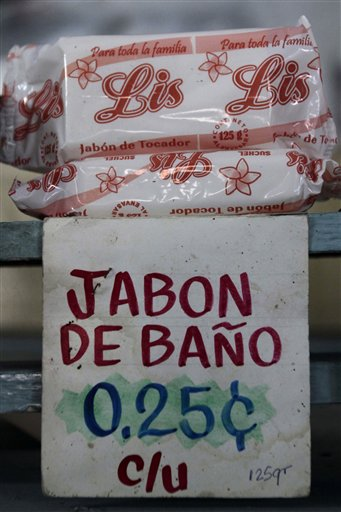 Soap sits for sale at a government store in Havana, Cuba, Wednesday Dec. 29, 2010. Cuba's official Gazette reported Wednesday that effective Jan. 1, 'personal cleanliness products' are to be cut from the ration books that islanders have come to rely on for a small but steady supply of basic goods. The ration program began in 1962 as a temporary way to guarantee food staples for all Cubans in the face of the United States' then-new embargo. Cubans currently pay about 25 centavos, or about a penny, for a rationed bar of soap. (AP Photo/Franklin Reyes)