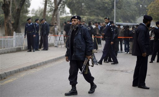 Pakistani police officers gather at the site where Punjab Gov. Salman Taseer was shot dead by one of his guards, in Islamabad, Pakistan, Tuesday, Jan. 4, 2011. The governor of Pakistan's powerful Punjab province was shot dead Tuesday by one of his guards in the Pakistani capital, police said, the killing was the most high-profile assassination of a political figure in Pakistan since the slaying of former Prime Minister Benazir Bhutto in December of 2007. (AP Photo/Muhammed Muheisen)