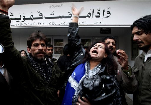 Supporters of Pakistan People's party mourn the death of Punjab's governor Salman Taseer who was shot dead by one of his guards, at a local hospital in Islamabad, Pakistan, on Tuesday, Jan. 4, 2011. The governor of Pakistan's powerful Punjab province was assassinated Tuesday by one of his guards. (AP Photo/B.K.Bangash)