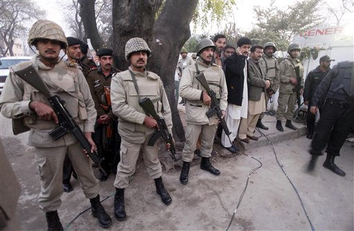 Troops of Pakistan's para military force stand guard outside a local hospital where Punjab's governor Salman Taseer's dead body was brought in Islamabad, Pakistan on Tuesday, Jan. 4, 2011. The governor of Pakistan's powerful Punjab province was shot dead Tuesday by one of his guards in the Pakistani capital, police said, the killing was the most high-profile assassination of a political figure in Pakistan since the slaying of former Prime Minister Benazir Bhutto in December of 2007. (AP Photo/B.K.Bangash)