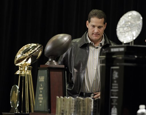 Auburn head coach Gene Chizik arrives at a news conference after the BCS National Championship NCAA college football game Tuesday, Jan. 11, 2011, in Scottsdale, Ariz. Auburn beat Oregon 22-19 to capture the championship. (AP Photo/Charlie Riedel)