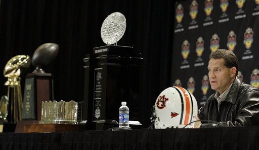 Auburn head coach Gene Chizik answers questions during a news conference after the BCS National Championship NCAA college football game, Tuesday, Jan. 11, 2011, in Scottsdale, Ariz. Auburn beat Oregon 22-19 to capture the championship. (AP Photo/Charlie Riedel)