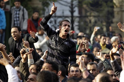 Angry Egyptian activist shouts at anti-riot policemen outside the journalists syndicate in downtown Cairo, Egypt, Wednesday, Jan. 26, 2011. A small gathering of Egyptian anti-government activists tried to stage a second day of protests in Cairo Wednesday in defiance of a ban on any gatherings, but police quickly moved in and used force to disperse the group. (AP Photo/Ben Curtis)