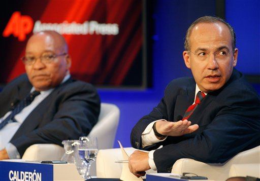 South Africa's President Jacob Zuma, left, and Mexico's President Felipe Calderon participate in a session on Climate Change at the World Economic Forum in Davos, Switzerland on Thursday, Jan. 27, 2011. Focus shifts on Thursday to the future of the euro and the issue of climate change. (AP Photo/Michel Euler)