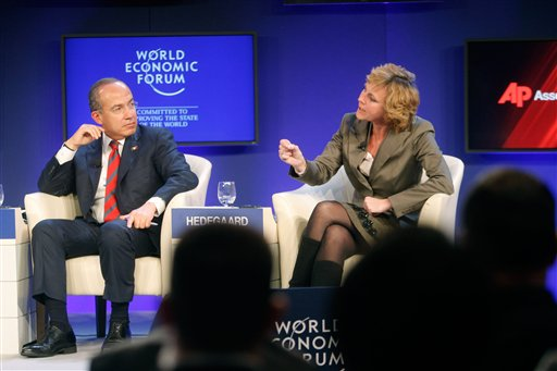Mexico's President Felipe Calderon, left, and European Commissioner for Climate Action Connie Hedegaard participate in a session on Climate Change at the World Economic Forum in Davos, Switzerland on Thursday, Jan. 27, 2011. Focus shifts on Thursday to the future of the euro and the issue of climate change. (AP Photo/Michel Euler)