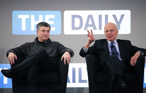 Rupert Murdoch, right, Chairman and CEO of News Corporation, and Eddy Cue, vice president of Apple, attend the launch of The Daily, Wednesday, Feb. 2, 2011 in New York. The Daily is the world's first iPad-only newspaper. (AP Photo/Mark Lennihan)