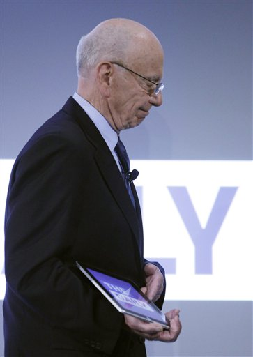 Rupert Murdoch, Chairman and CEO of News Corporation, holds an iPad during the launch of The Daily, Wednesday, Feb. 2, 2011 in New York. The Daily is the world's first iPad-only newspaper. (AP Photo/Mark Lennihan)
