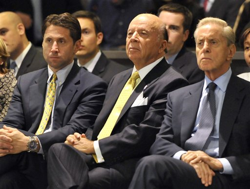 FILE - In this Oct. 29, 2010, file photo, New York Mets Chief Operating Officer Jeff Wilpon, left, club president Saul Katz and Mets owner Fred Wilpon, right, look on during a baseball news conference in New York. The owners of the Mets turned a blind eye to Bernard Madoff's massive fraud, reaping $300 million in false profits and using a large chunk to run the team, according to a lawsuit unsealed Friday, Feb. 4, 2011. The lawsuit claims the owners were so dependent on the disgraced financier's too-good-to-be-true returns that it 'faced a severe and immediate liquidity crisis' when Madoff's crimes were revealed in 2009. (AP Photo/Kathy Kmonicek, File)