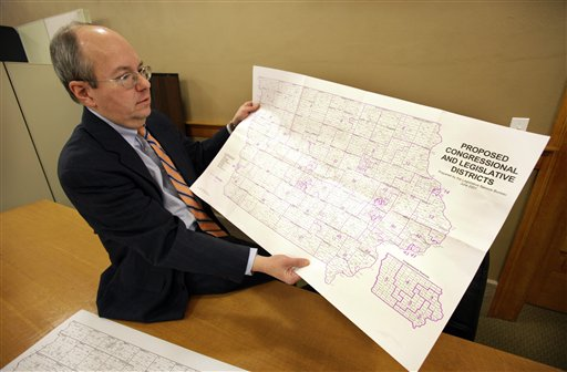 Ed Cook, legal counsel for the Iowa Legislative Services Agency, holds a map of Iowa that will be used to help in drawing new congressional district lines, Wednesday, Feb. 9, 2011, in Des Moines, Iowa. The once-a-decade process of redistricting is a bare-knuckles display of politics as incumbents seek to protect their districts and parties scramble for any advantage - except in Iowa where three nonpartisan staffers redraw the lines, focused solely on making districts compact and equal in population. (AP Photo/Charlie Neibergall)