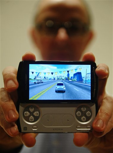 A new mobile phone 'Xperia play' by Sony Ericsson is displayed at in Barcelona, Spain, Sunday, Feb. 13, 2011. The Xperia Play phone has a slide-out control pad that mimics that of a PlayStation Portable. It will go on sale through Verizon Wireless in the U.S. in April. The Mobile World Congress will be held from Feb. 14-17. (AP Photo/Manu Fernandez)