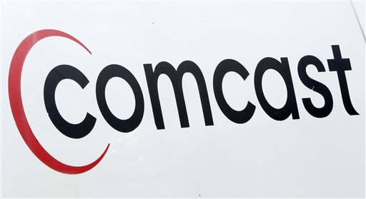 This Comcast logo is displayed on an installation truck in Pittsburgh, Tuesday, Feb. 15, 2011. Comcast Corp., a leading cable, entertainment and communications company, announced Wednesday, Feb. 16, that the company's planned annual dividend has increased 19% to $0.45 per share. (AP Photo/Gene J. Puskar)