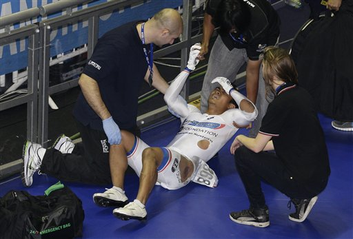 Malaysia's Azizulhasni Awang collapses with a splinter through his lower leg after a crash in the Men's Keirin Final during the Track Cycling World Cup at the National Cycling Centre, Manchester, England, Saturday Feb. 19, 2011. (AP Photo/Jon Super)