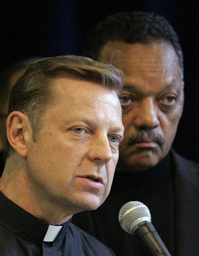 FILE - In this June 1, 2007 file photo, the Rev. Michael Pfleger, pastor of St. Sabina Church in Chicago, is seen with Rev. Jesse Jackson during a press conference at Rainbow/Push Coalition headquarters in Chicago. Pfleger was interviewed by The Associated Press on the challenges that will face Chicago's next mayor. The election is Feb. 22, 2011. (AP Photo/M. Spencer Green, File)