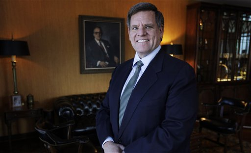 In his photo taken Feb. 14, 2011, cago Blackhawks CEO Rocky Wirtz, poses in front of a painting of his grandfather Arthur Wirtz in Chicago. Wirtz was interviewed by The Associated Press on the challenges that will face Chicago's next mayor. The election is Feb. 22, 2011. (AP Photo/M. Spencer Green)
