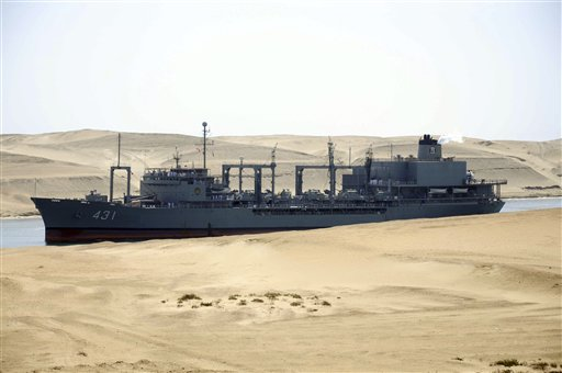 The Iranian navy's replenishment vessel IS Kharg passes through the Suez canal at Ismailia, Egypt, Tuesday, Feb.22, 2011. The Kharg accompanied by the frigate IS Alvand entered the Suez Canal on Tuesday en route to Syria, officials said, the first time in three decades that Tehran has sent military ships through the strategic waterway.(AP Photo)