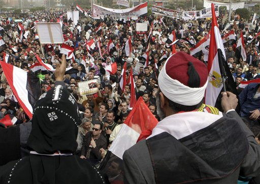 An Egyptian Muslim Sheikh, at right, and a Coptic bishop waves Egyptian flags, as they mean a sign of solidarity, as thousands gather at Tahrir Square, the focal point of the Egyptian uprising, in Cairo, Egypt, Friday, Feb.25, 2011.The deputy to Osama bin Laden issued al-Qaida's second message since the Egyptian uprising, accusing the nation's Christian leadership of inciting interfaith tensions and denying that the terror network was behind last month's bombing of a Coptic church in Alexandria that killed 21 and sparked protests. (AP Photo/Amr Nabil)