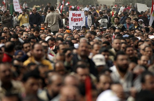 Egyptian protesters attend Friday prayers in Tahrir Square, Cairo, Egypt, Friday, Feb. 25, 2011. Tens of thousands rallied in Cairo's Tahrir Square on Friday, trying to keep up pressure on Egypt's military rulers to carry out reforms and calling for the dismissal of holdovers from the regime of ousted President Hosni Mubarak. (AP Photo/Khalil Hamra)