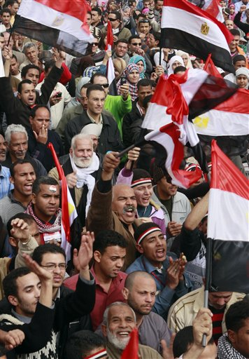 Egyptians wave by their flags at Tahrir Square, the focal point of the Egyptian uprising, in Cairo, Egypt, Friday, Feb. 25, 2011. The deputy to Osama bin Laden issued al-Qaida's second message since the Egyptian uprising, accusing the nation's Christian leadership of inciting interfaith tensions and denying that the terror network was behind last month's bombing of a Coptic church in Alexandria that killed 21 and sparked protests. (AP Photo/Amr Nabil)