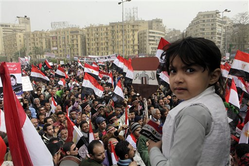 An Egyptian girl looks on as thousands gather at Tahrir Square, the focal point of the Egyptian uprising, in Cairo, Egypt, Friday, Feb.25, 2011. The deputy to Osama bin Laden issued al-Qaida's second message since the Egyptian uprising, accusing the nation's Christian leadership of inciting interfaith tensions and denying that the terror network was behind last month's bombing of a Coptic church in Alexandria that killed 21 and sparked protests. (AP Photo/Amr Nabil)