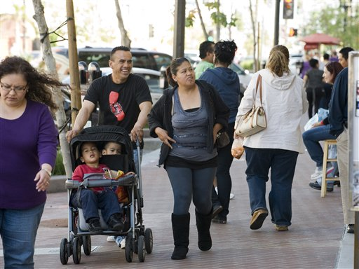 Families shop in downtown Santa Ana, Calif. on Tuesday, March 8, 2011. Surging Latino and Asian populations accounted for virtually all of California�s population growth over the last decade, new census data showed on Tuesday. In the decade spanning 2000 and 2010, Latinos grew by 28 percent to 14 million in the nation�s most populous state, while Asians grew even faster, by 31 percent, to reach 4.8 million. In contrast, non-Hispanic whites decreased by 5 percent and the state�s African-American population dipped by 1 percent. Over the decade, California�s population grew only 10 percent to 37.3 million, ranking just 20th nationally and lagging behind other western states such as Nevada and Arizona. (AP Photo/Orange County Register, Jebb Harris)