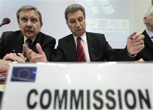 European Commissioner for Energy Guenther Oettinger, center, and the Director of the European Commission Energy Directorate Nuclear Energy Department Peter Faross, attend a hastily convened meeting of energy ministers, nuclear regulators and industry officials in Brussels, Tuesday, March 15, 2011. The European Union on Tuesday considers stress tests to see how its 143 nuclear plants would react in emergencies and says it might have to reassess the construction procedures in the wake of Japan's crisis. (AP Photo/Yves Logghe)