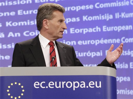 European Commissioner for Energy Guenther Oettinger addresses the media after a hastily convened meeting of energy ministers, nuclear regulators and industry officials in Brussels, Tuesday, March 15, 2011. The European Union on Tuesday considers stress tests to see how its 143 nuclear plants would react in emergencies and says it might have to reassess the construction procedures in the wake of Japan's crisis. (AP Photo/Yves Logghe)