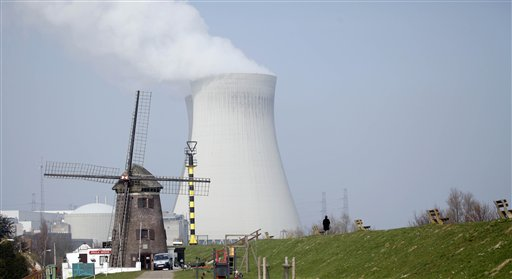 A nuclear cooling tower is seen next to a historical windmill in Doel, Belgium on Tuesday, March 15, 2011. In response to events taking place in Japan, the Belgian government has opened a website with information on evacuation in the event of a nuclear accident and also said that they will make iodine tablets available to all residents in the evacuation zone. Belgium currently has two operating nuclear power plants. (AP Photo/Virginia Mayo)