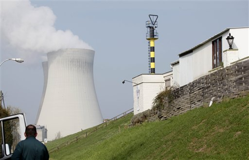 A man looks at a nuclear cooling tower in Doel, Belgium on Tuesday, March 15, 2011. In response to events taking place in Japan, the Belgian government has opened a website with information on evacuation in the event of a nuclear accident and also said that they will make iodine tablets available to all residents in the evacuation zone. Belgium currently has two operating nuclear power plants. (AP Photo/Virginia Mayo)
