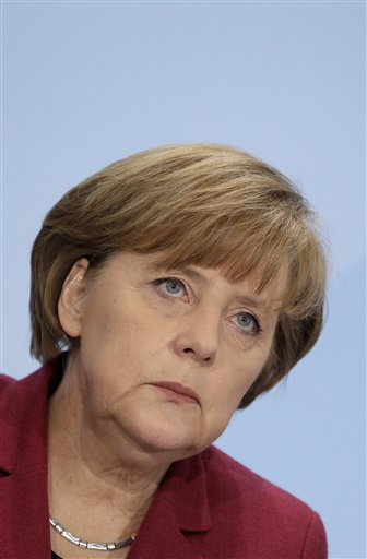 German Chancellor Angela Merkel attends a news conference in Berlin, Germany, Tuesday, March 15, 2011. Germany will take seven of its 17 nuclear reactors offline for three months while the country reconsiders plans to extend the life of its atomic power plants in the wake of events in Japan, Chancellor Angela Merkel said Tuesday. (AP Photo/Michael Sohn)