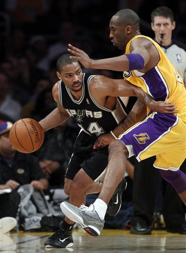 San Antonio Spurs' Gary Neal, left, drives around Los Angeles Lakers' Kobe Bryant during the first half of an NBA basketball game in Los Angeles, Tuesday, April 12, 2011. (AP Photo/Chris Carlson)
