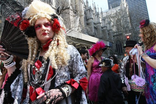 Wearing a costume, Giovanni Figueroa of the Brooklyn borough of New York, left, poses for photographs as he and others take part in the Easter Parade along New York's Fifth Avenue on Sunday, April 24, 2011. (AP Photo/Tina Fineberg)