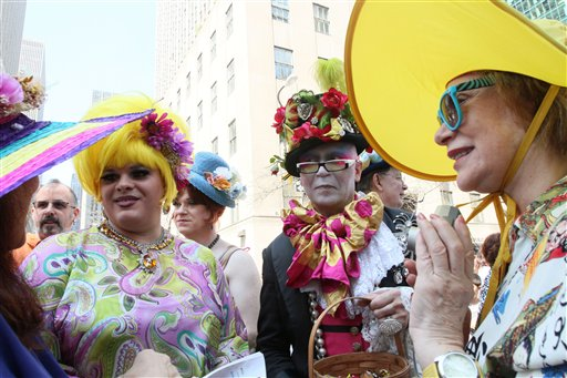 Mariette Pathy Allen, right, and others talk with other participants in the Easter Day parade along New York's Fifth Avenue on Sunday, April 24, 2011. (AP Photo/Tina Fineberg)