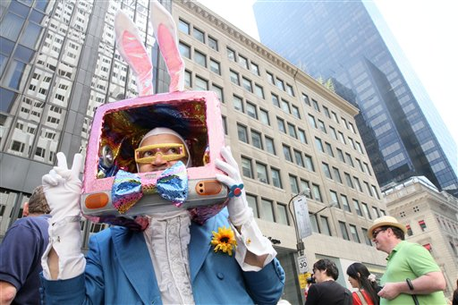 Dressed as a rabbit television, Davey Mitchell, of New York, left, poses for photographs as he takes part in the Easter Parade along New York's Fifth Avenue Sunday April 24, 2011. (AP Photo/Tina Fineberg)