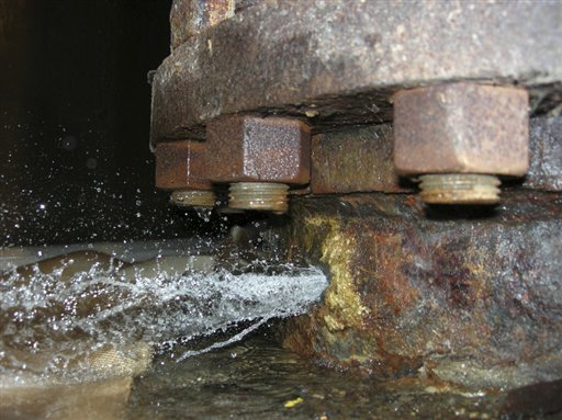 This photo made available by the Nuclear Regulatory Commission shows a 10-gallon-per-minute leak which sprung Oct. 19, 2007, in rusted piping that carried essential service water at the Byron nuclear plant in Illinois. The water is needed to cool the reactor in an emergency. The plant was immediately taken offline for repairs. Federal regulators have been working closely with the nuclear power industry to keep the nation's aging reactors operating within safety standards by repeatedly weakening those standards, or simply failing to enforce them, an investigation by The Associated Press has found. Time after time, officials at the U.S. Nuclear Regulatory Commission have decided that original regulations were too strict, arguing that safety margins could be eased without peril, according to records and interviews. (AP Photo/Nuclear Regulatory Commission)