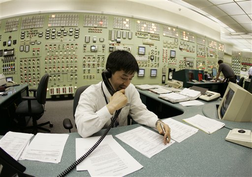 In this Friday, April 20, 2007 picture, Tracy Sudoko, a control room agent at the Indian Point nuclear power plant, works on a report at the facility in Buchanan, N.Y. Commercial nuclear reactors in the United States were designed and licensed for 40 years. When the first ones were being built in the 1960s and 1970s, it was expected that they would be replaced with improved models long before those licenses expired. Instead, 66 of the 104 operating units have been relicensed for 20 more years, mostly with scant public attention. As of 2011, renewal applications are under review for 16 other reactors. Applications to extend the lives of pressurized water units 2 and 3 at Indian Point, each more than 34 years old, are under review by the NRC. (AP Photo/Julie Jacobson)