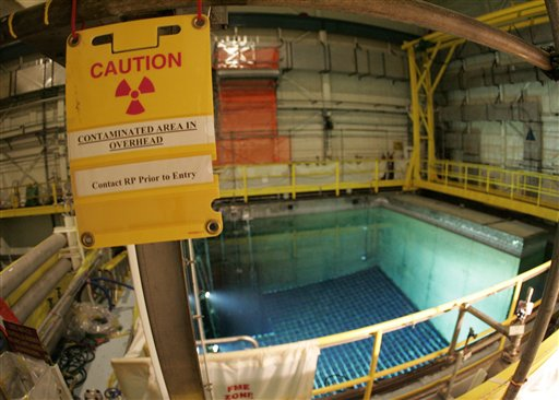 In this Friday, April 20, 2007 picture, a caution sign marks an area surrounding a pool that protects spent nuclear fuel at the Indian Point nuclear power station in Buchanan, N.Y. Because the federal government has failed to find a location for permanent storage of spent fuel, many tons of highly radioactive used reactor rods are kept in pools inside reactor containment buildings. (AP Photo/Julie Jacobson)