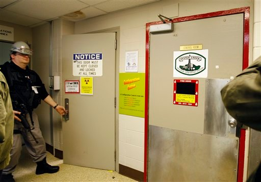 In this Thursday, Feb. 25, 2010 picture, an armed security guard works outside the control room at the Oyster Creek nuclear plant in Lacey Township, N.J. Called 'Oyster Creak' by some critics because of its aging problems, this boiling water reactor began running in 1969 and ranks as the country's oldest operating commercial nuclear power plant. Its license was extended in 2009 until 2029, though utility officials announced in December 2010 that they'll shut the reactor 10 years earlier, rather than build state-ordered cooling towers. (AP Photo/Mel Evans)