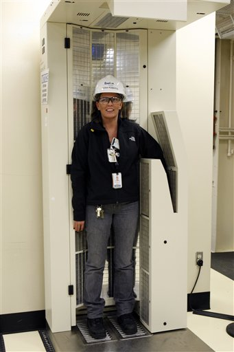 In this Thursday, Feb. 25, 2010 picture, Exelon's Fiona Roberts stands in a machine that identifies her and scans for radioactivity as she leaves an area at the Oyster Creek nuclear generating plant in Lacey Township, N.J. The facility in southern New Jersey is the country's oldest operating nuclear reactor. (AP Photo/Mel Evans)