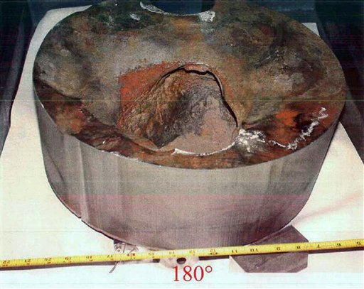 This undated photo made available by the Nuclear Regulatory Commission shows a 5-by-5-inch hole in a section cut from the top of the reactor vessel at the Davis-Besse nuclear plant in Ohio. Discovered in February 2002, the hole was eaten by boric acid that spilled from inside the reactor through cracks in the vessel head. Only three-eighths of an inch of steel cladding remained, making a reactor breach likely in as little as two months, by the NRC's estimate. (AP Photo/Nuclear Regulatory Commission)