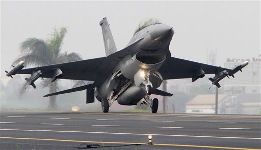 FILE - In this April 12, 2011 file image, a Taiwan Air Force F-16 fighter lands on a section of highway during a military drill in Madou, Tainan city, south of Taiwan. A U.S. decision not to sell Taiwan new F-16 fighter jets is being seen by many U.S. allies in Asia as a sign of China's growing clout. (AP Photo/Chiang Ying-ying, File)