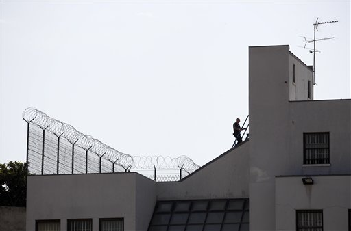 A Portuguese policeman is seen walking on the roof of the Portuguese Judiciary Police headquarters where U.S. fugitive George Wright is reportedly being held in Lisbon Thursday, Sept. 29, 2011. Wright was arrested Sept. 26, 2011 by Portuguese authorities at the request of the U.S. government after more than 40 years as a fugitive, authorities said. The FBI says Wright, who escaped the Bayside State Prison in Leesburg, N.J., in 1970, became affiliated with the Black Liberation Army and in 1972 he and his associates hijacked a Delta flight from Detroit to Miami. After releasing the passengers in exchange for a $1 million ransom, the hijackers forced the plane to fly to Boston, then on to Algeria. Wright is being held in Lisbon, the capital of Portugal, pending extradition hearings. He has asked to be released while the extradition process goes forward, and the court handling the case is considering his request, according to U.S. officials. (AP Photo/ Francisco Seco)