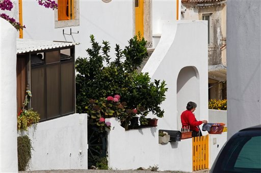 A woman who said she was Maria Do Rosario Valente, the wife of fugitive George Wright is seen outside the house where neighbors said Wright lived in Almocagema, near Lisbon Wednesday, Sept. 28, 2011. Wright was arrested Sept. 26, 2011 by Portuguese authorities at the request of the U.S. government after more than 40 years as a fugitive, authorities said. The FBI says Wright, who escaped the Bayside State Prison in Leesburg, N.J., in 1970, became affiliated with the Black Liberation Army and in 1972 he and his associates hijacked a Delta flight from Detroit to Miami. After releasing the passengers in exchange for a $1 million ransom, the hijackers forced the plane to fly to Boston, then on to Algeria. (AP Photo/ Francisco Seco)