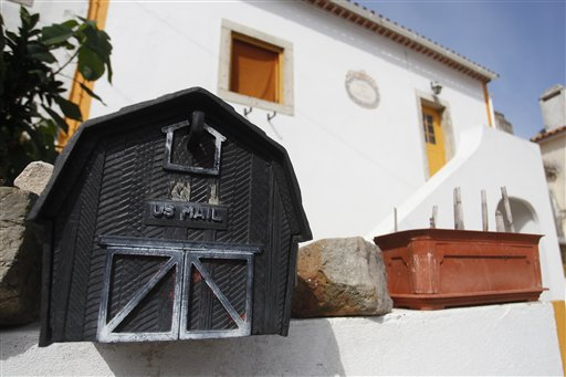 A mailbox with the words U.S. Mail is seen outside the house where neighbors said fugitive George Wright lived in Almocagema, near Lisbon Wednesday, Sept. 28, 2011. Wright was arrested Sept. 26, 2011 by Portuguese authorities at the request of the U.S. government after more than 40 years as a fugitive, authorities said. The FBI says Wright, who escaped the Bayside State Prison in Leesburg, N.J., in 1970, became affiliated with the Black Liberation Army and in 1972 he and his associates hijacked a Delta flight from Detroit to Miami. After releasing the passengers in exchange for a $1 million ransom, the hijackers forced the plane to fly to Boston, then on to Algeria. (AP Photo/ Francisco Seco)
