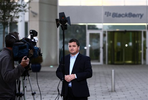 Research in Motion's (RIM) United Kingdom managing director, Stephen Bates, speaks to media outside the headquarters of RIM who invented the BlackBerry in Slough, England, Wednesday Oct. 12, 2011. Sporadic outages of BlackBerry messaging and email service spread to the U.S. and Canada on Wednesday, as problems stretched into the third day for Europe, Asia, Latin America and Africa. (AP Photo/PA, Steve Parsons) UNITED KINGDOM OUT NO SALES NO ARCHIVE
