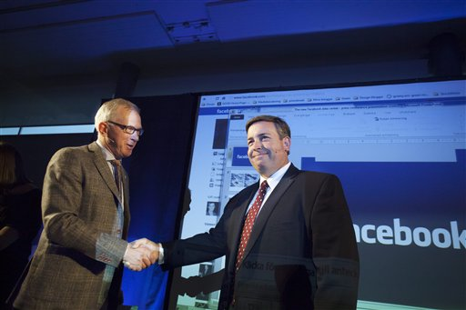 Luleas county President Karl Petersen, left, shakes hands with Tom Furlong, Facebook Director of Operations, as Furlong announces Thursday Oct. 27, 2011 in Lulea, Sweden, that it's new server farm on the edge of the Arctic Circle, it's first outside the U.S. will improve performance for European users of the social networking site. Facebook confirmed Thursday it had picked the northern Swedish city of Lulea for the data center partly because of the cold climate � crucial for keeping the servers cool � and access to renewable energy from nearby hydropower facilities. (AP Photo/Susanne Lindholm) SWEDEN OUT