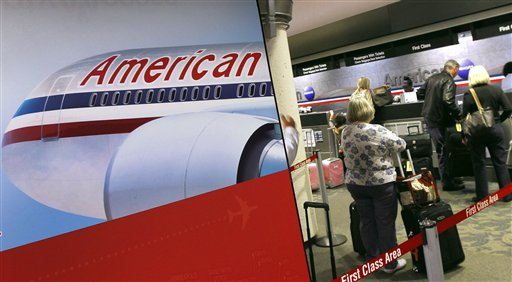 American Airlines passengers line up at the ticket counter Tuesday, Nov. 29, 2011, at Sky Harbor International Airport in Phoenix. American Airlines and its parent company AMR are filing for Chapter 11 bankruptcy protection as they seek to cut costs and unloadmassive debt built up by years of high jet fuel prices and labor struggles. (AP Photo/Matt York)