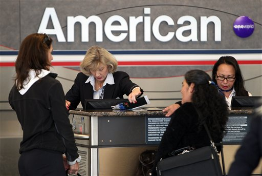 Passengers check-in at an American Airlines ticketing counter at Dallas Fort Worth Airport Tuesday, Nov. 29, 2011, in Dallas. American Airlines and its parent company AMR are filing for Chapter 11 bankruptcy protection as they seek to cut costs and unload massive debt built up by years of high jet fuel prices and labor struggles.(AP Photo/Richard W. Rodriguez)